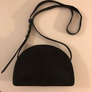 Black crossbody half moon leather bag